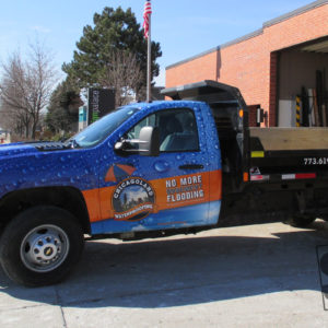 chevy pick up truck fully wrap with custom rain drop graphics and the customers logo