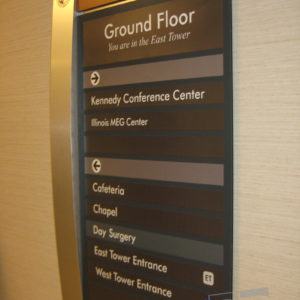 custom wayfinding sign with brushed aluminum cured detail and suite inserts