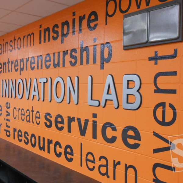 digitally printed vinyl heat applied to cmu block with .75'' cast aluminum letters