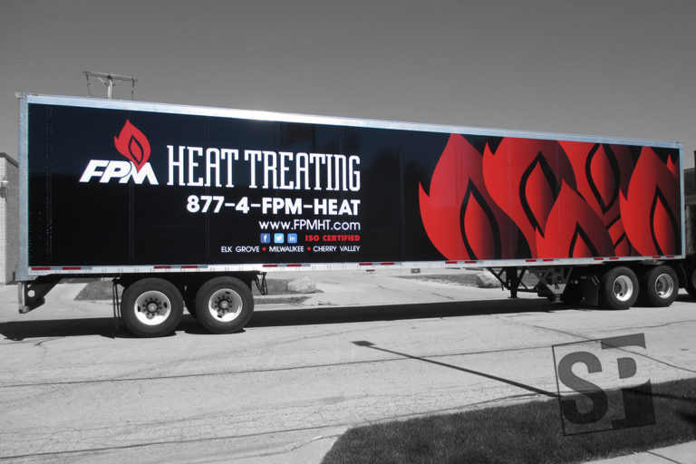 fpm heat treating tractor and trail wrap with custom flame graphics and company logos