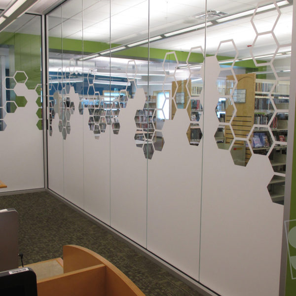 honey comb window graphics for the addison libary to seperate rooms with matte white vinyl