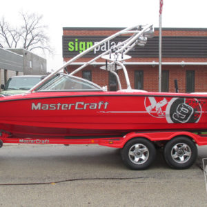 mastercraft x9 custom metallic silver and black vinyl ski and wakeboard boat