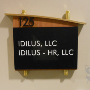 room plaque with wood finish, gold stand-offs and removable tenant insert